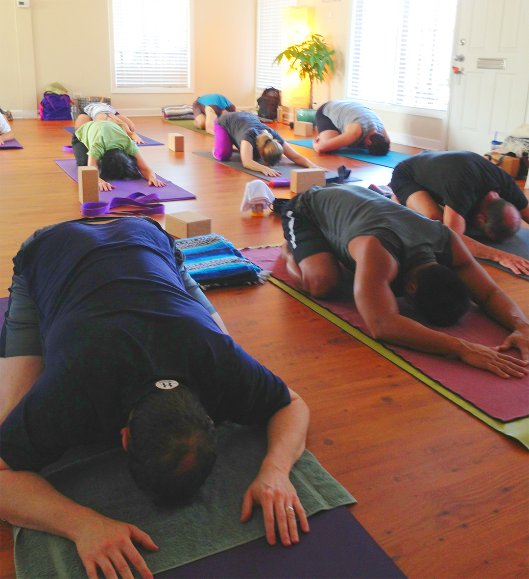 child's pose in a private group class