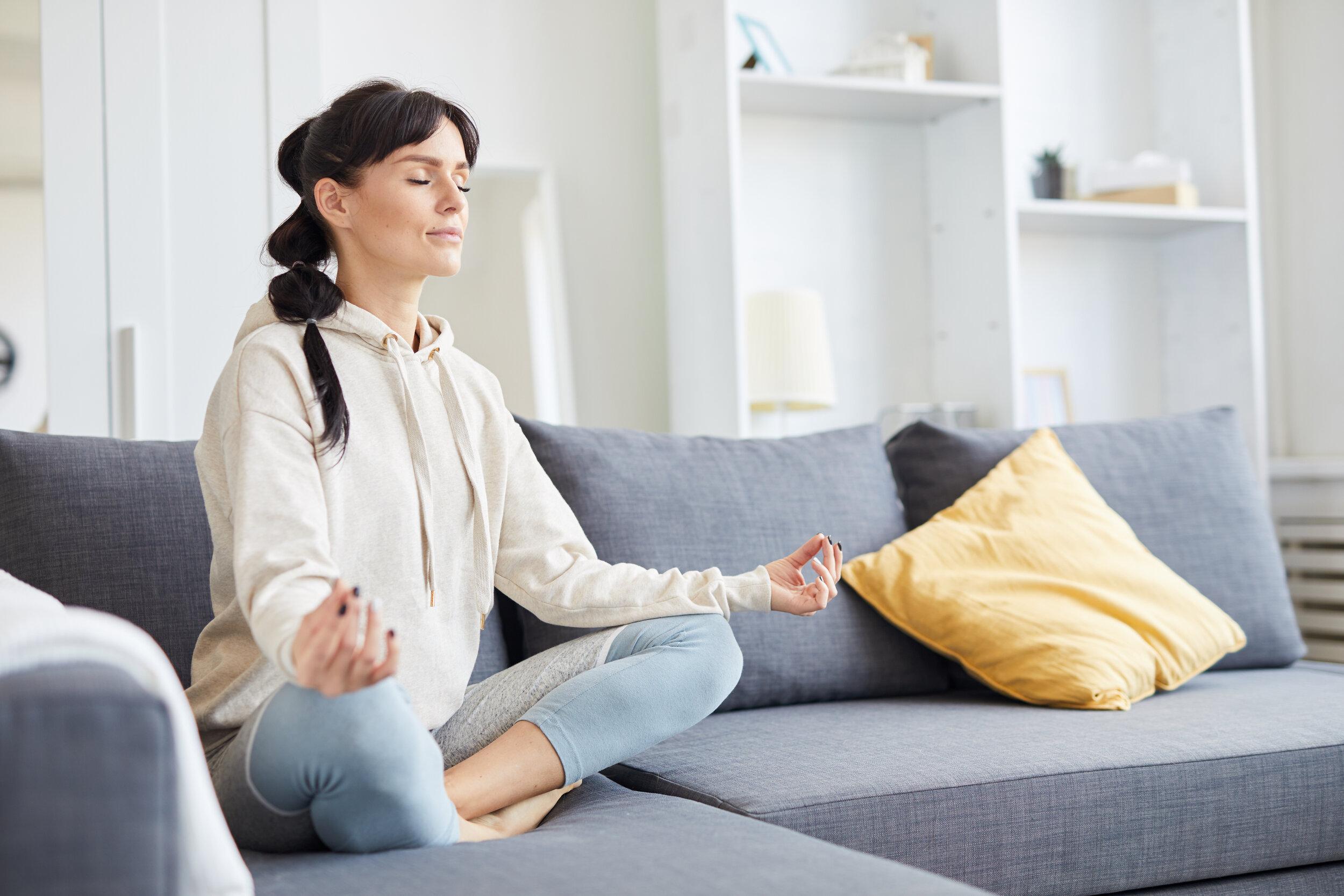 woman-practicing-yoga-BU5K9RX.jpg