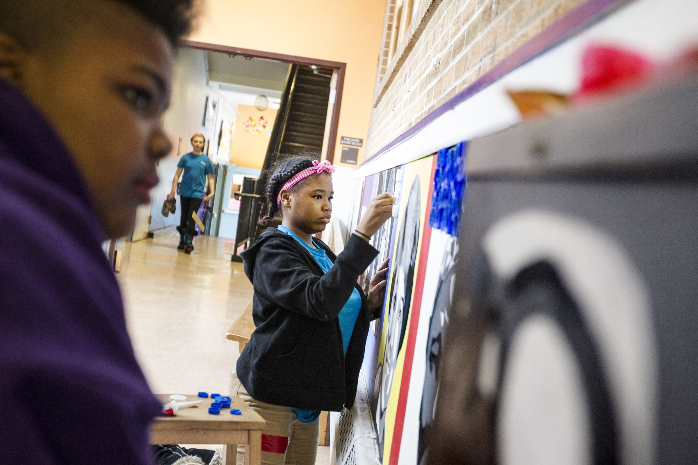 Students decorate LJA's halls with portraits of significant women throughout history.