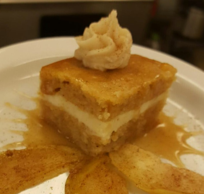 Apple cake with 5-spice cream cheese frosting, served over spiced baked apples drizzled with apple caramel sauce.