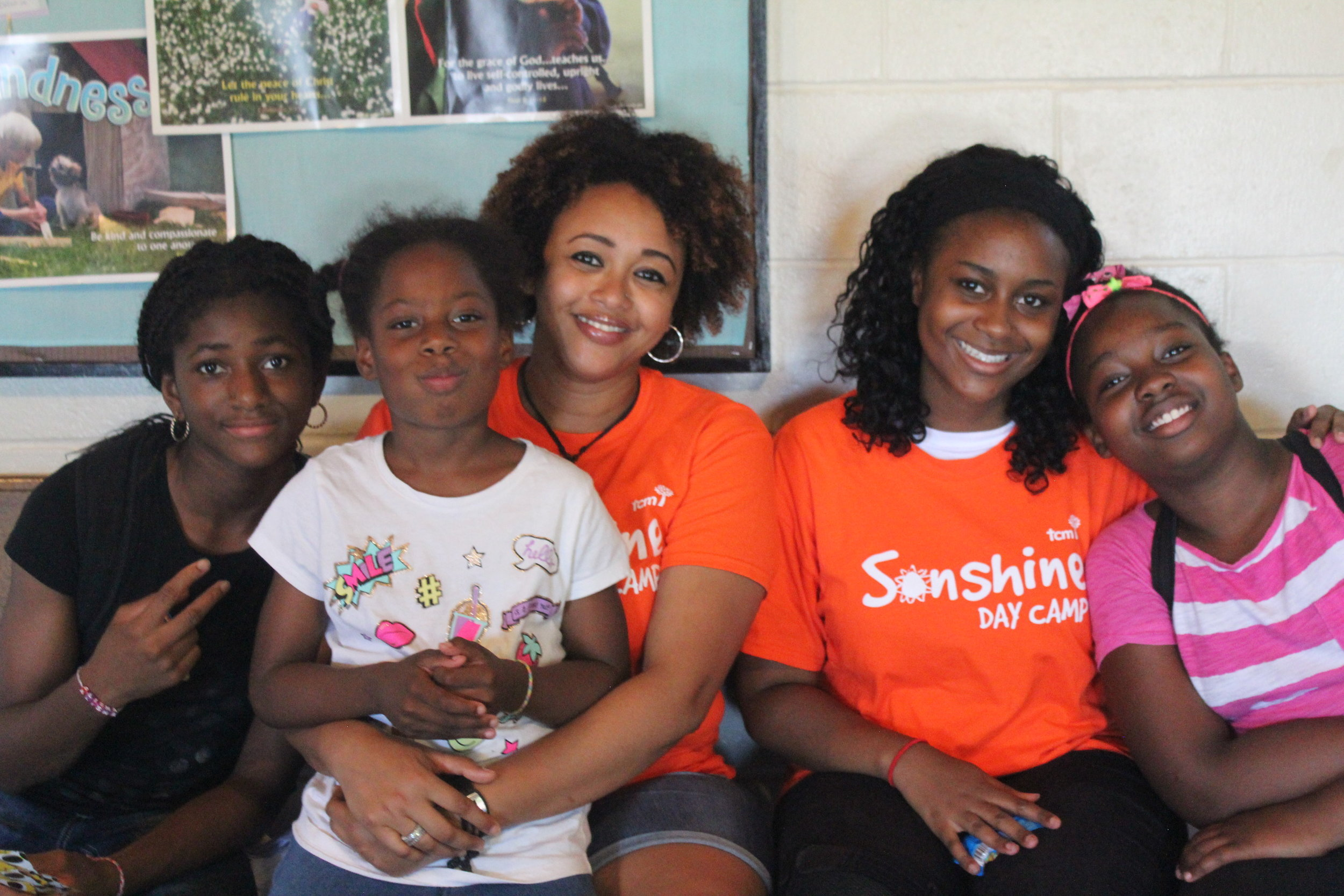 Enniael (second from the right), with kids from Kingston-Galloway.