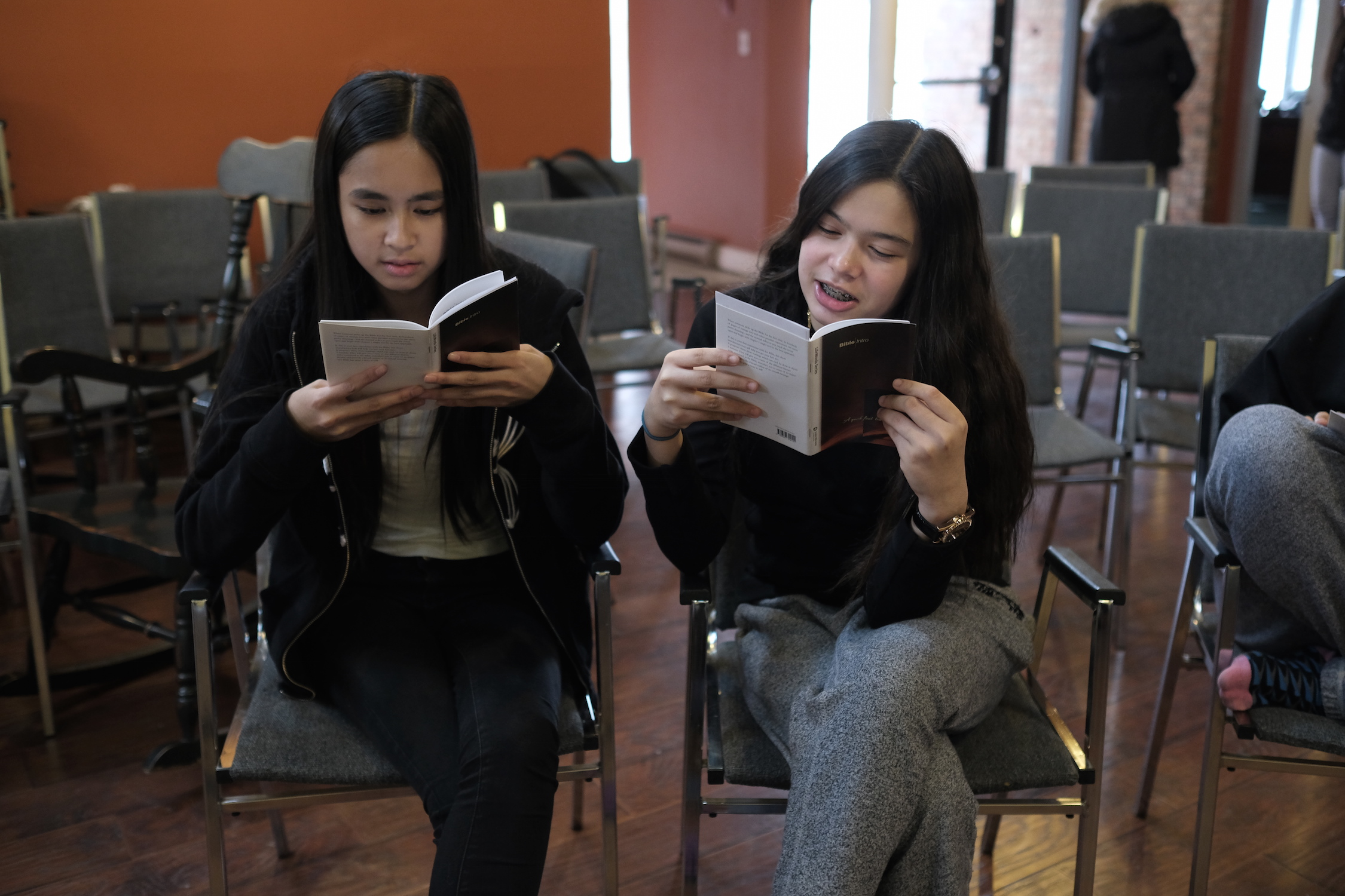 Teens in St. James Town studying scripture