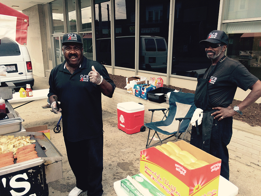 CJ and Reggie get ready for an onslaught of hungry kids.