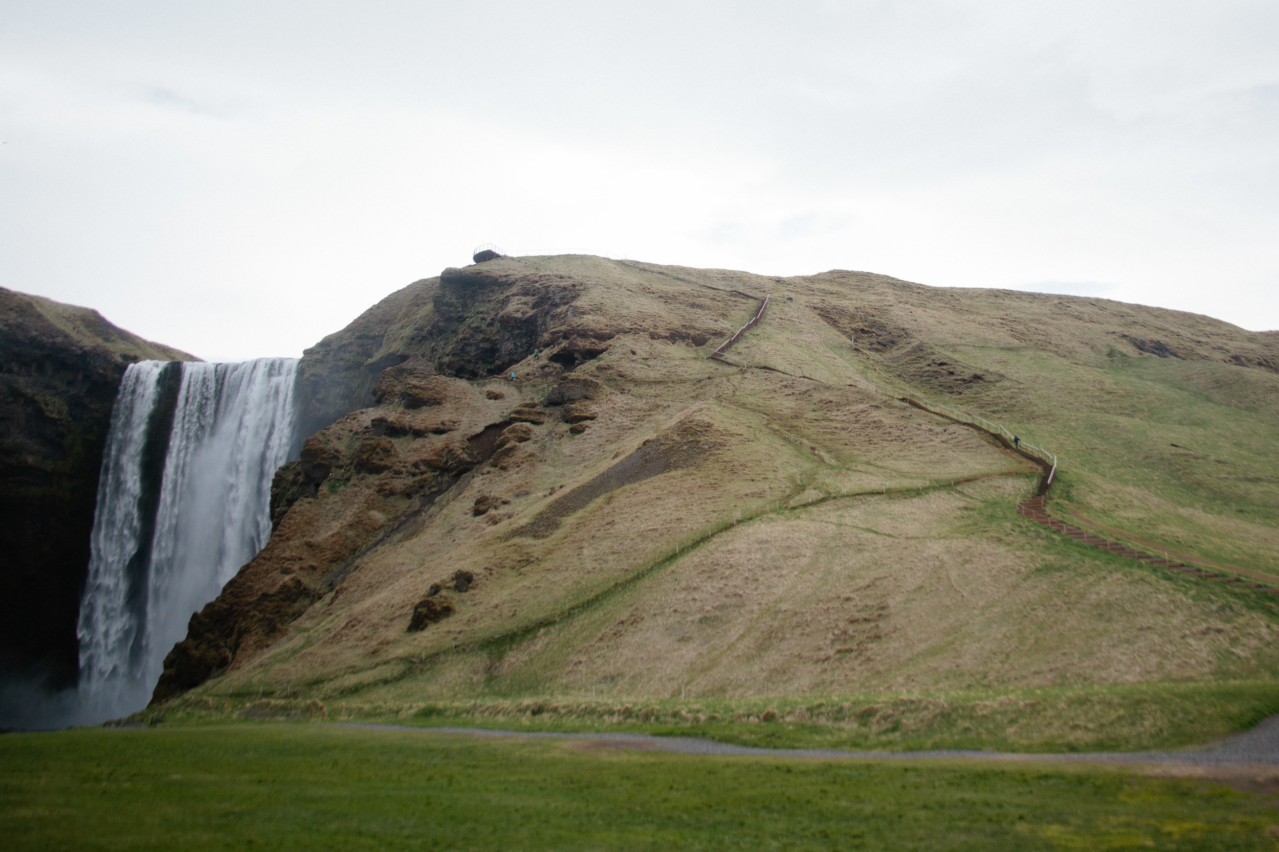 Skogarfoss - that zig-zag line on the left is the trail to the top! And that little black spot is a person!
