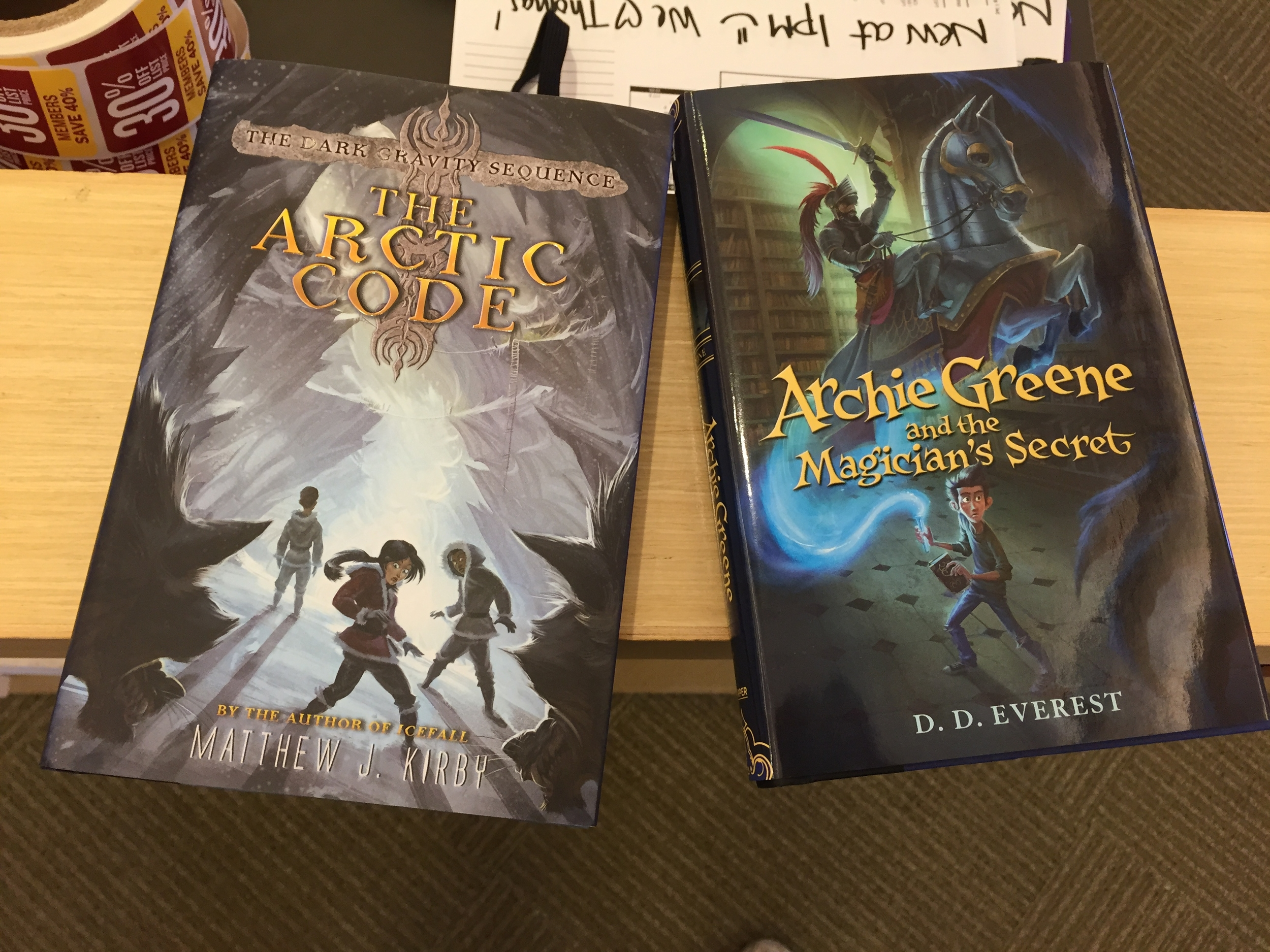 Arctic Code and Archie Greene book covers on the shelves!