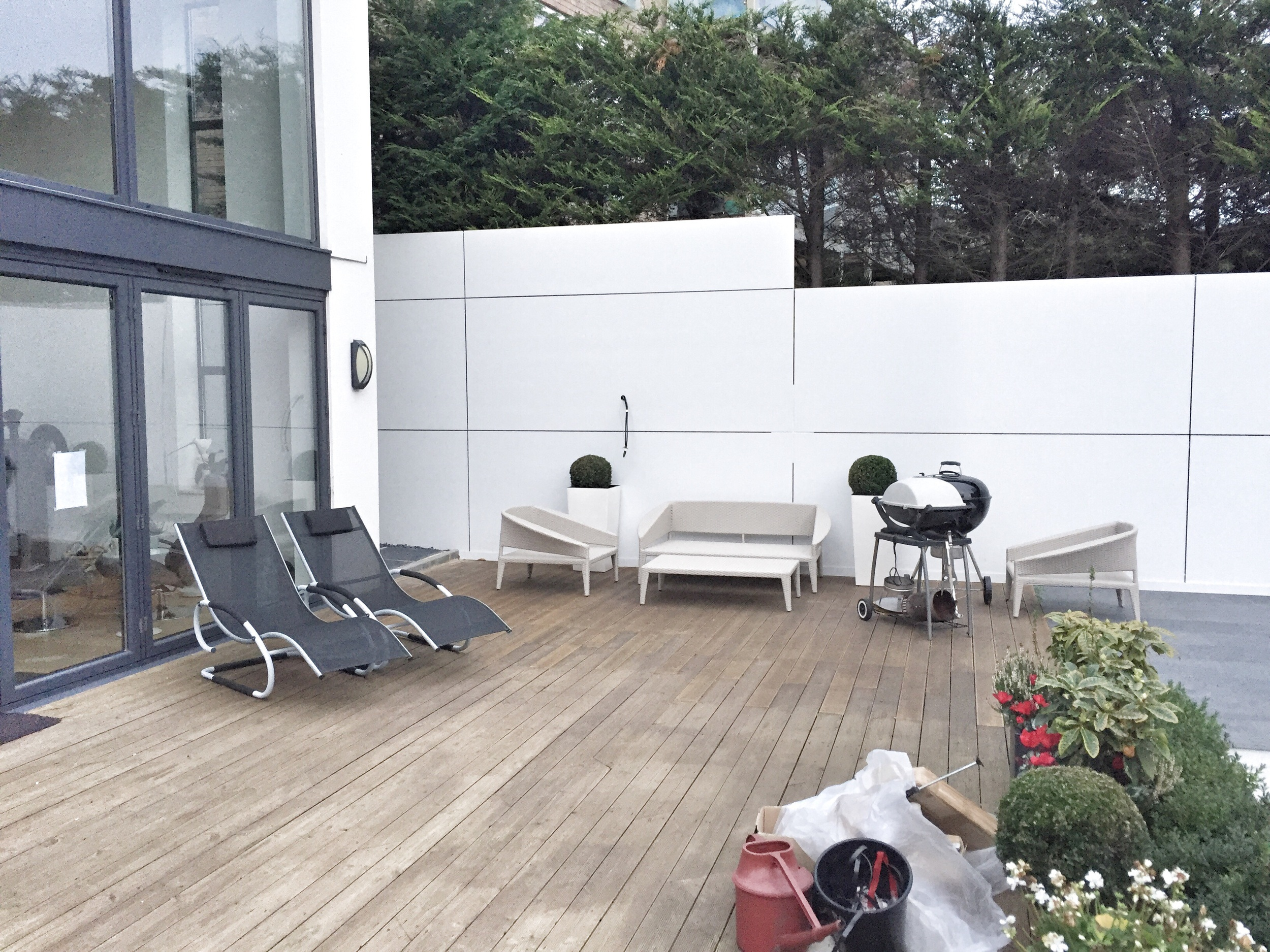 The customer has oiled the decking to attain a darker colour.