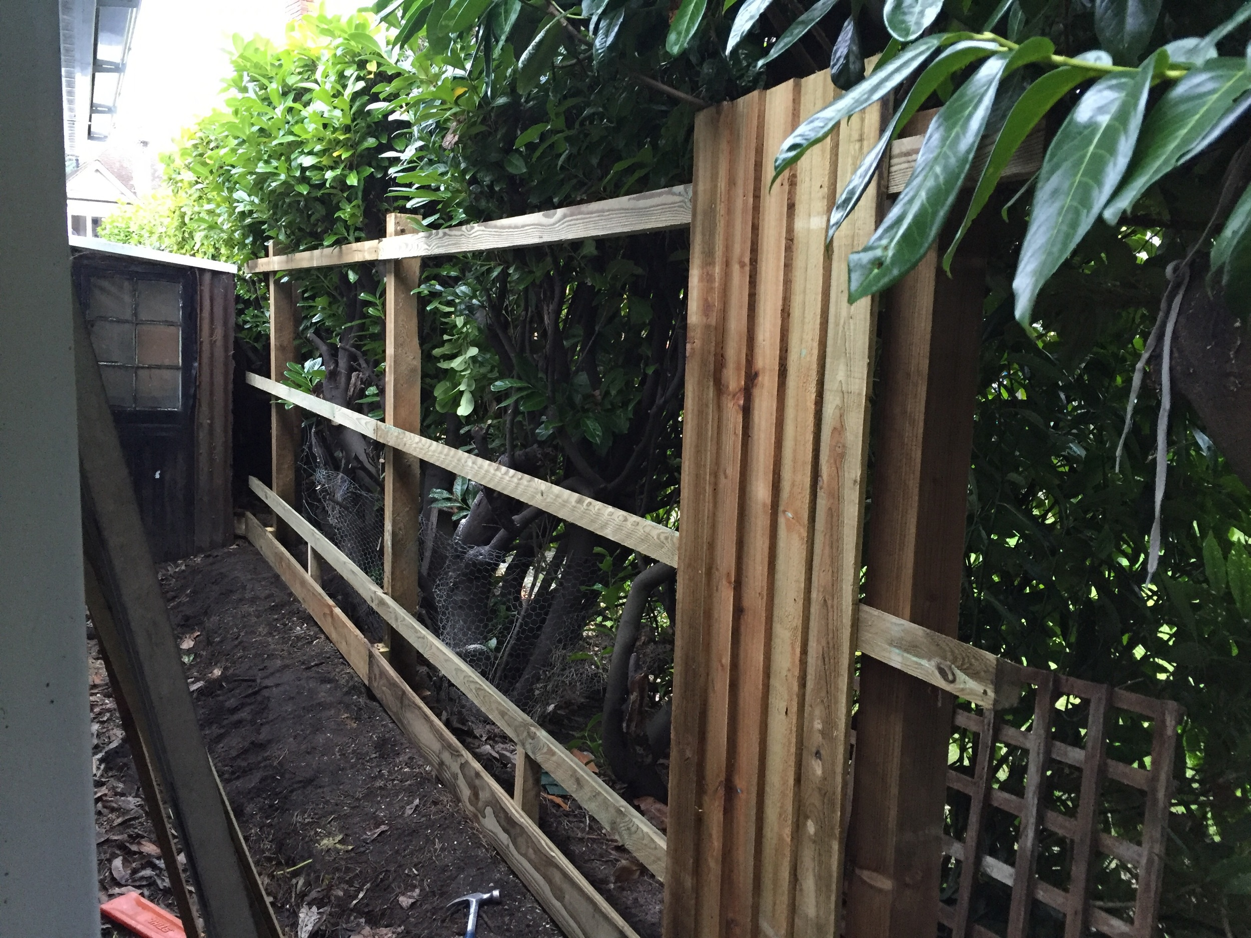 The gravel boards and bevelled rails are now fitted, using pegs to fix the bottom rail to the gravel board.