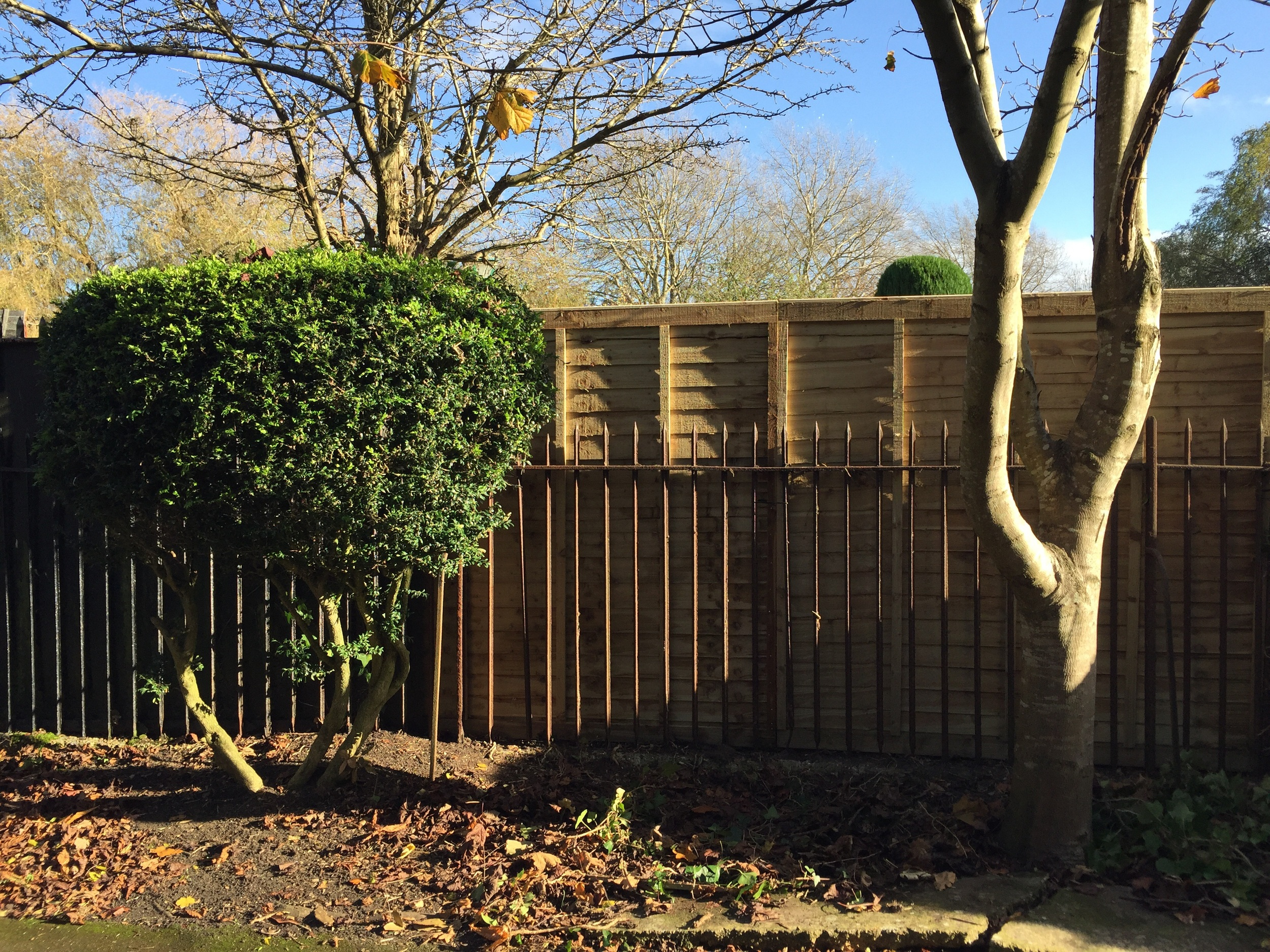 Panels were fitted behind metal railings, posts concreted behind so as to be concealed.