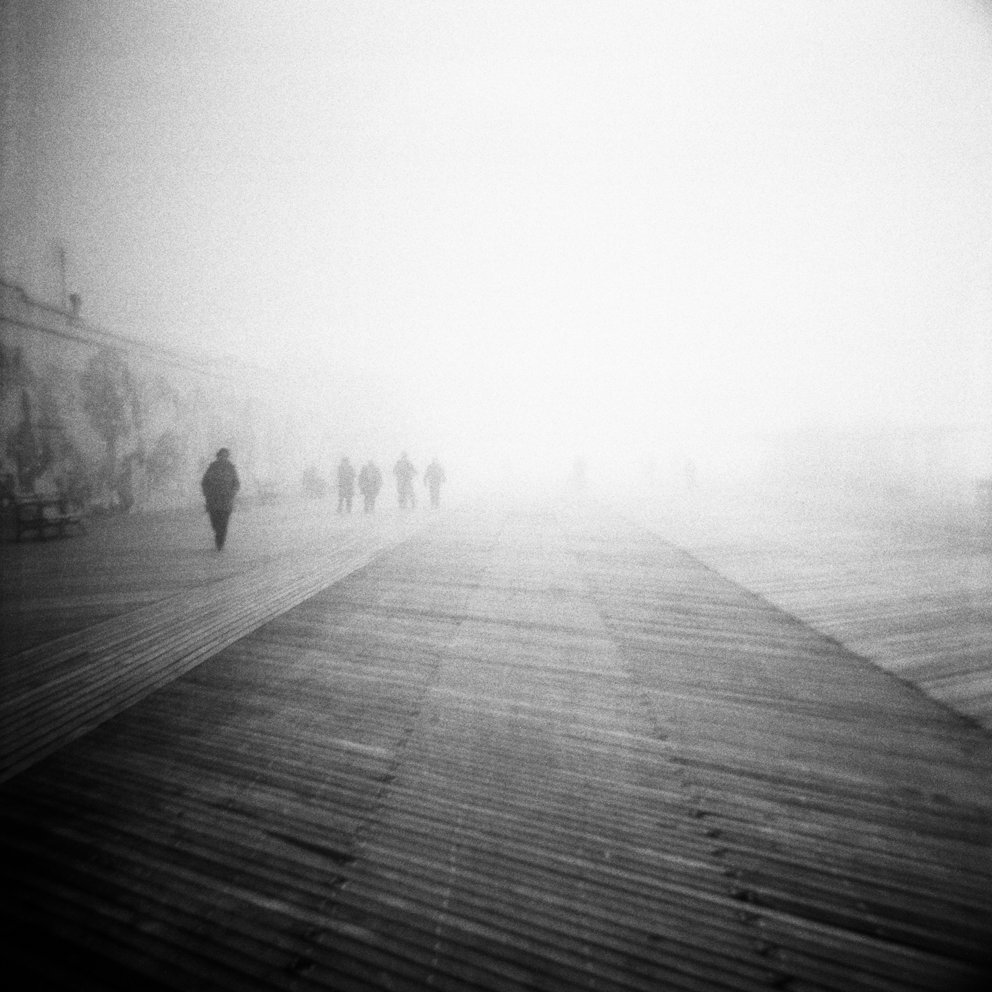 FIGURES ON BOARDWALK