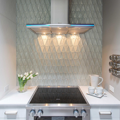 Dimensional glass tile mosaic from Oceanside Glasstile in a modern Santa Fe kitchen.   Available at Statements.
