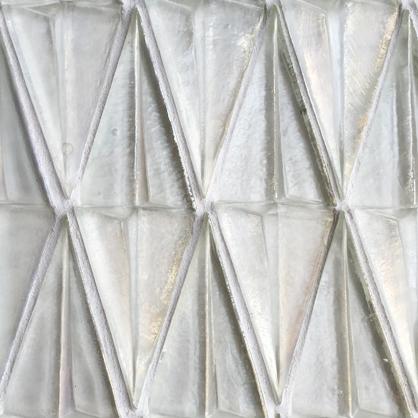 Dimensional glass mosaic tile.