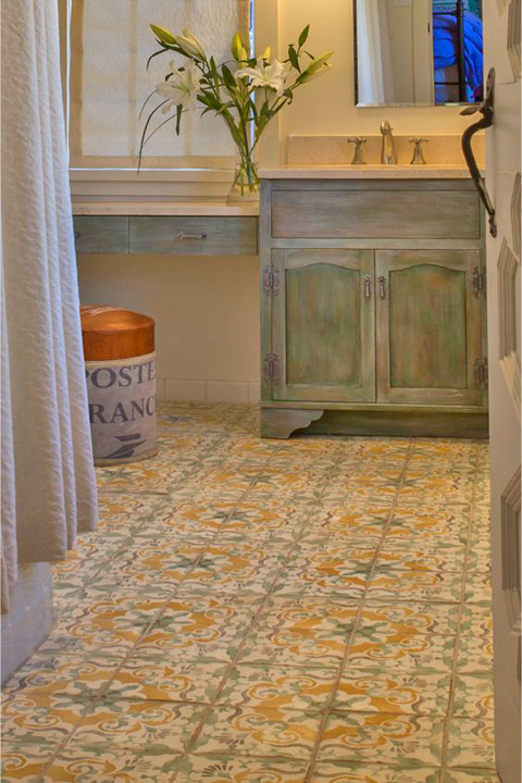 Floral flooring makes this bathroom a delight.