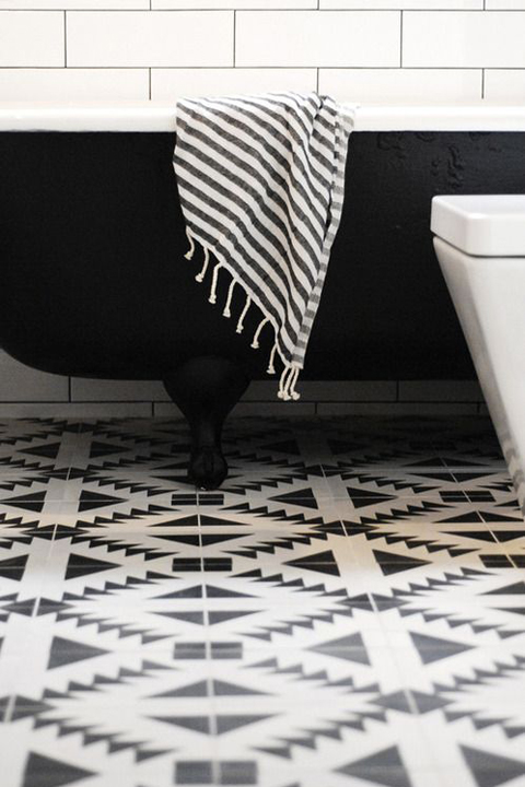 Black and white floor tile with a tribal flair.