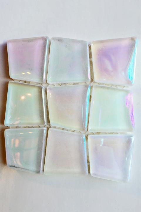 Asymmetrical pearlescent glass tile.