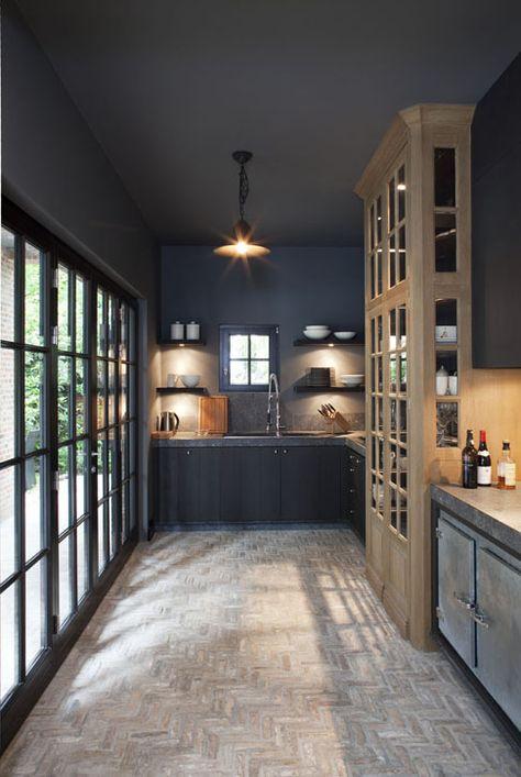 Design Credit to Frank Missotten - Dark kitchen interior