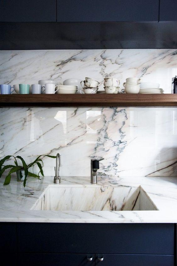Black/marble kitchen photo courtesy of Remodelista