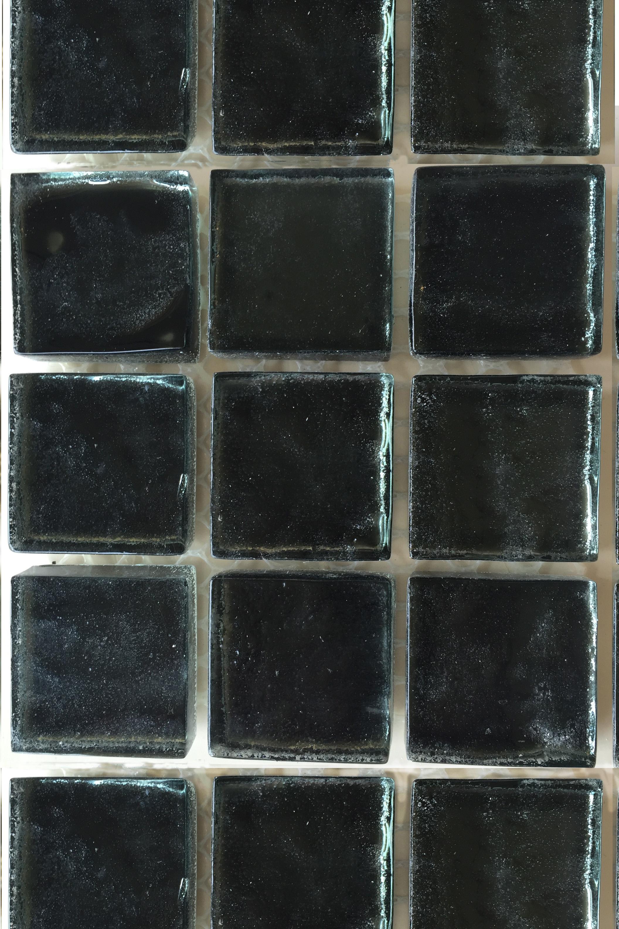 Dark bluegreen glass mosaic tile.