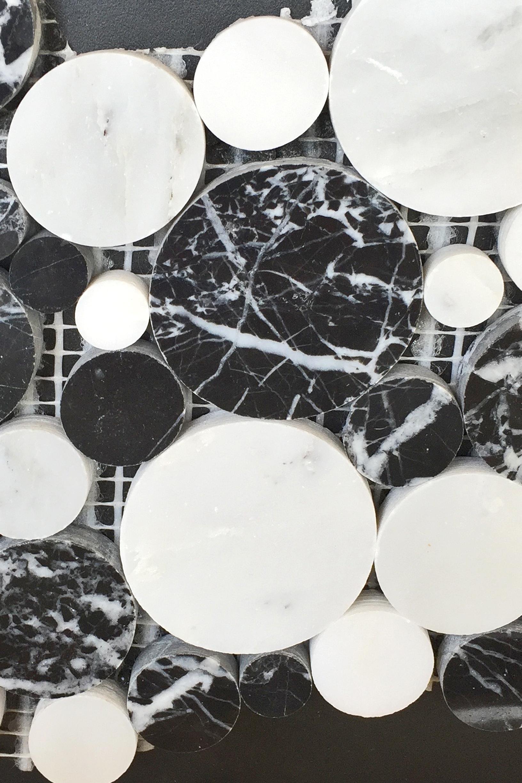 Irregular black and white polka-dot tile