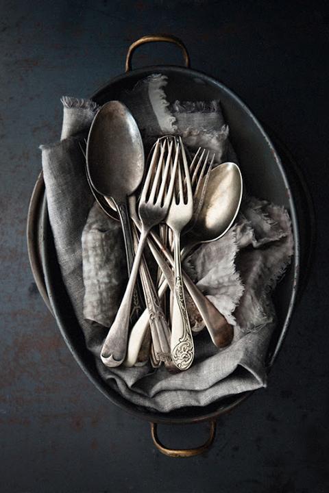 Vintage Silverware in a black bowl.