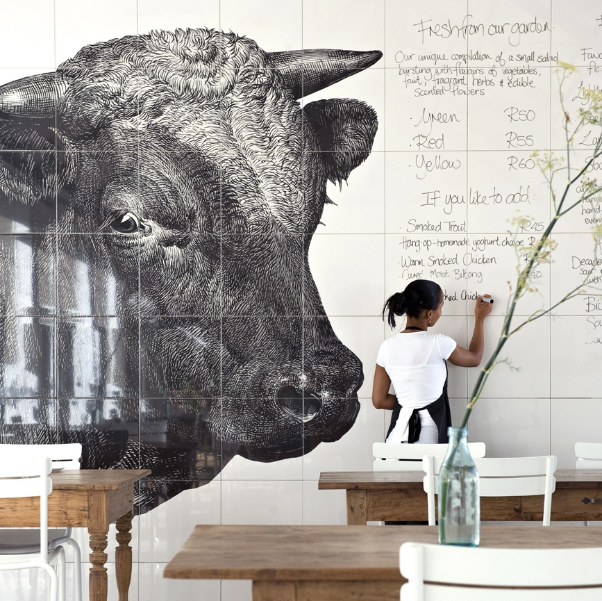 The menu wall at Babylonstoren Hotel in South Africa, a restaurant and working farm in one. The menu is hand written on the tiled walls daily.