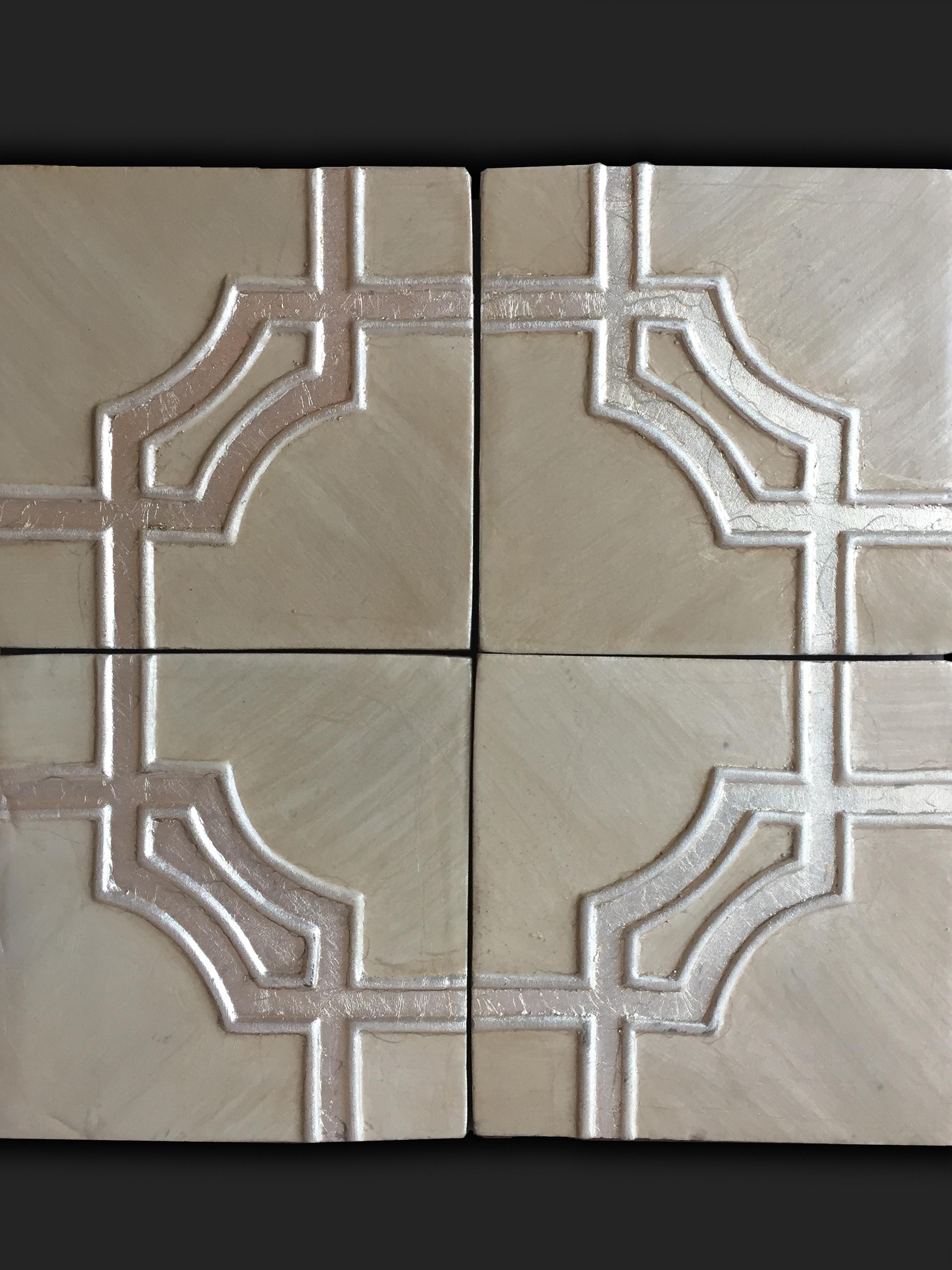 Gold lace patterned tile.