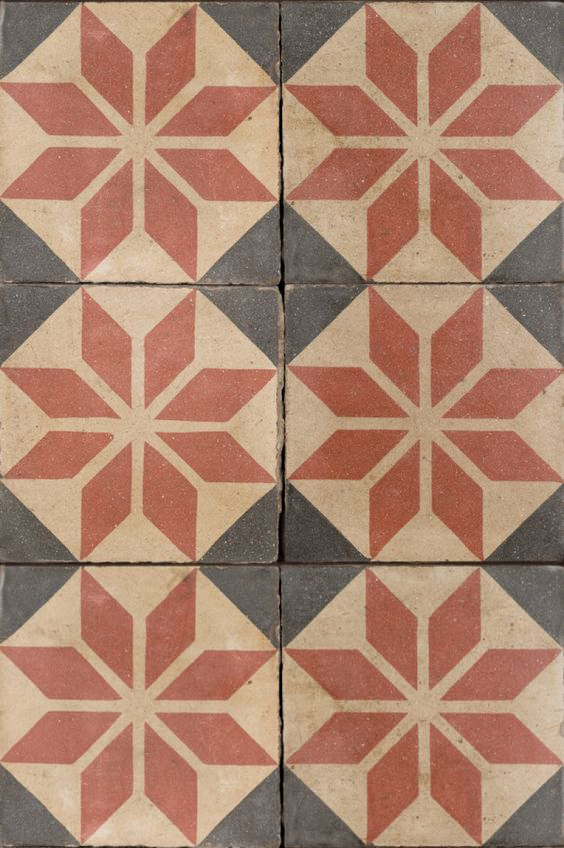 Antique red and black star pattern tile.