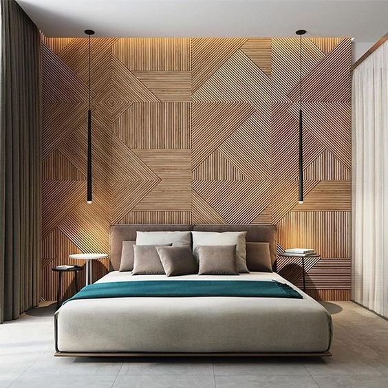 Wood wall bedroom with long tapered black hanging lights by Studio DeNew Architects.