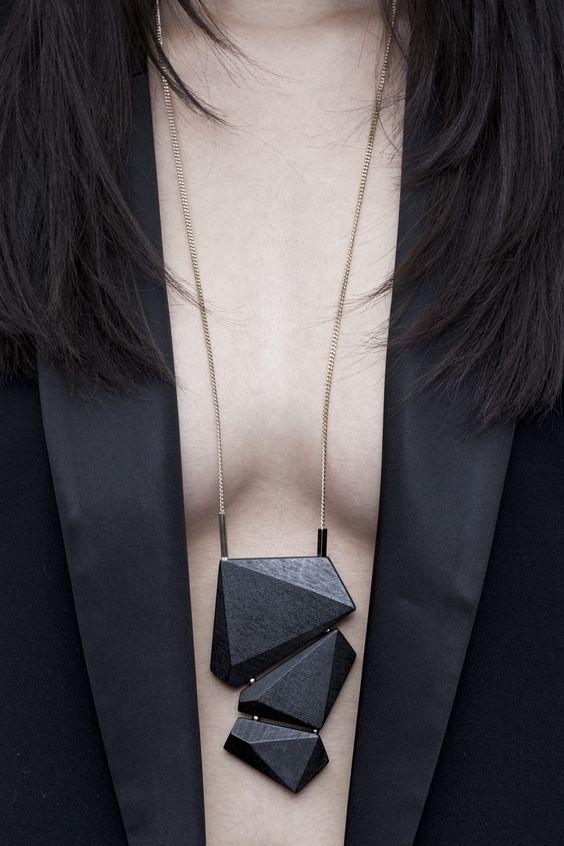 Black angular long pendant.