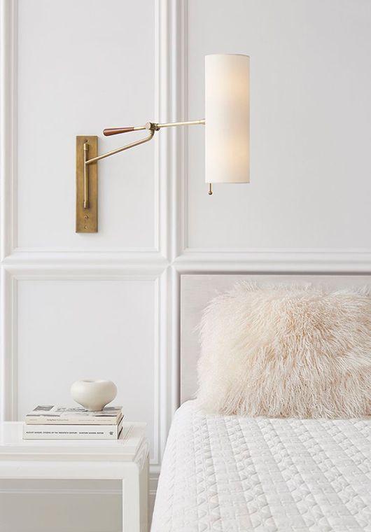 Brass swing arm bedside reading lamp.