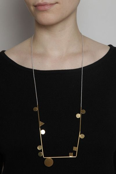Long angular gold necklace with circles and squares.