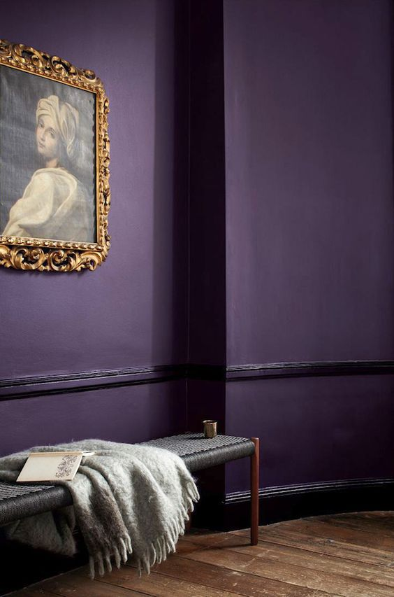 Violet wall with golden antique painting and frame, Mon Cahiers d'Images.