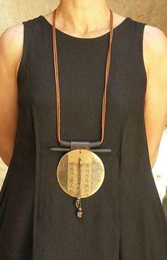 Long pendant necklace.