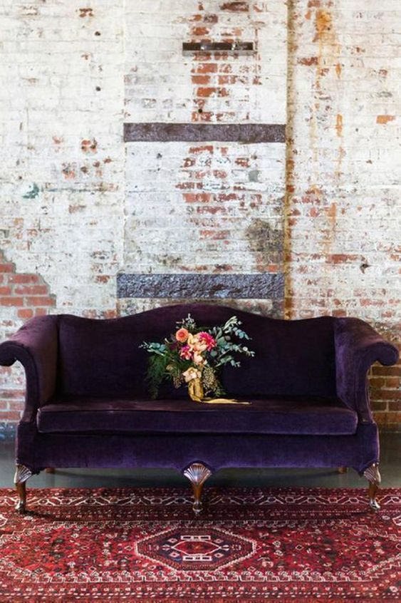 Purple velvet couch with Persian rug, Inside Out.
