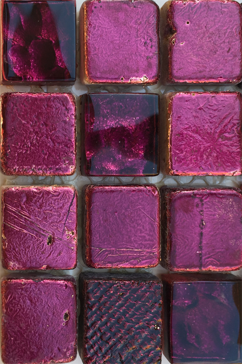 Glass mosaic tile in deep violet and pink.