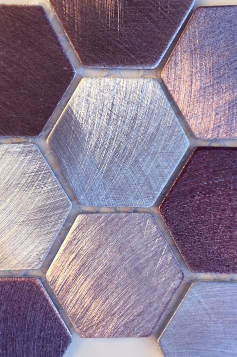 Metallic hexagon mosaic tile.