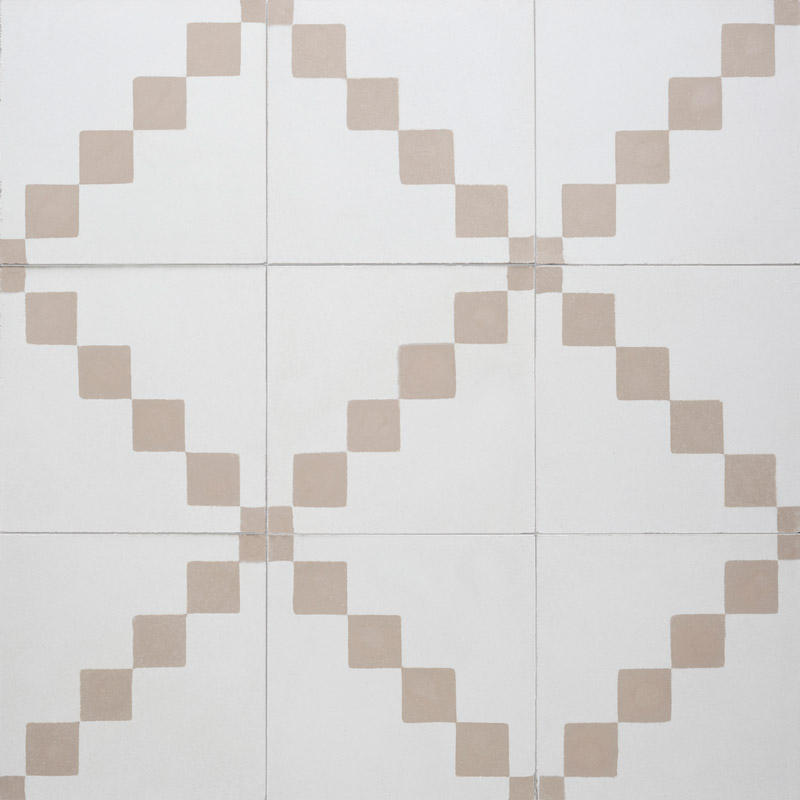 Cement tile in subtle neutral background with earth colored square pattern, diagonal.