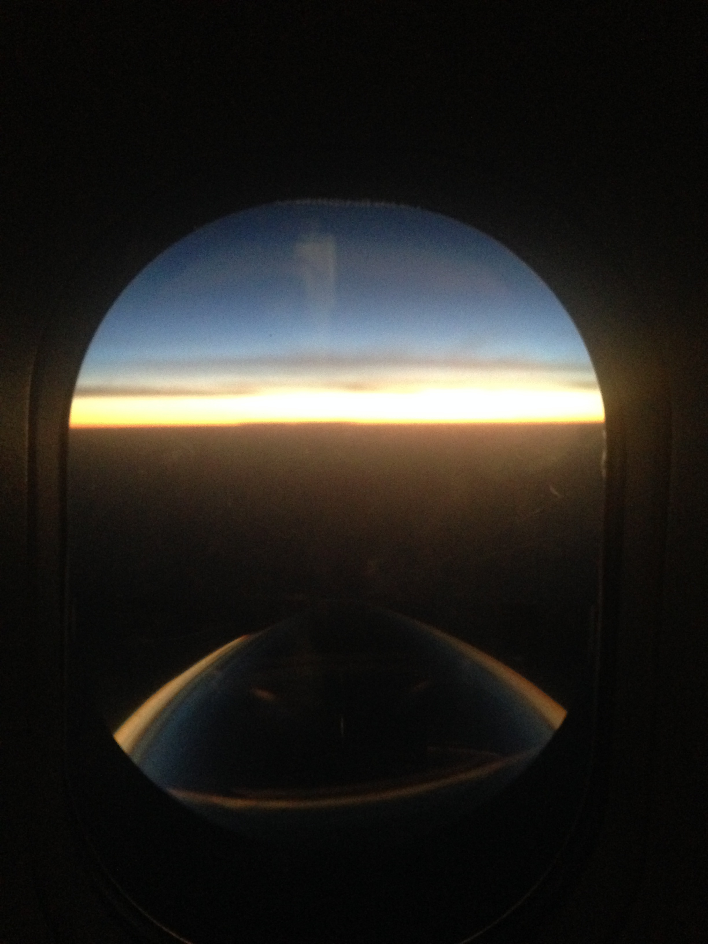 ^  First glimpses of the day at about 40,000 ft.