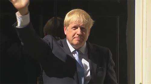 Boris Johnson waves hello LR.jpg