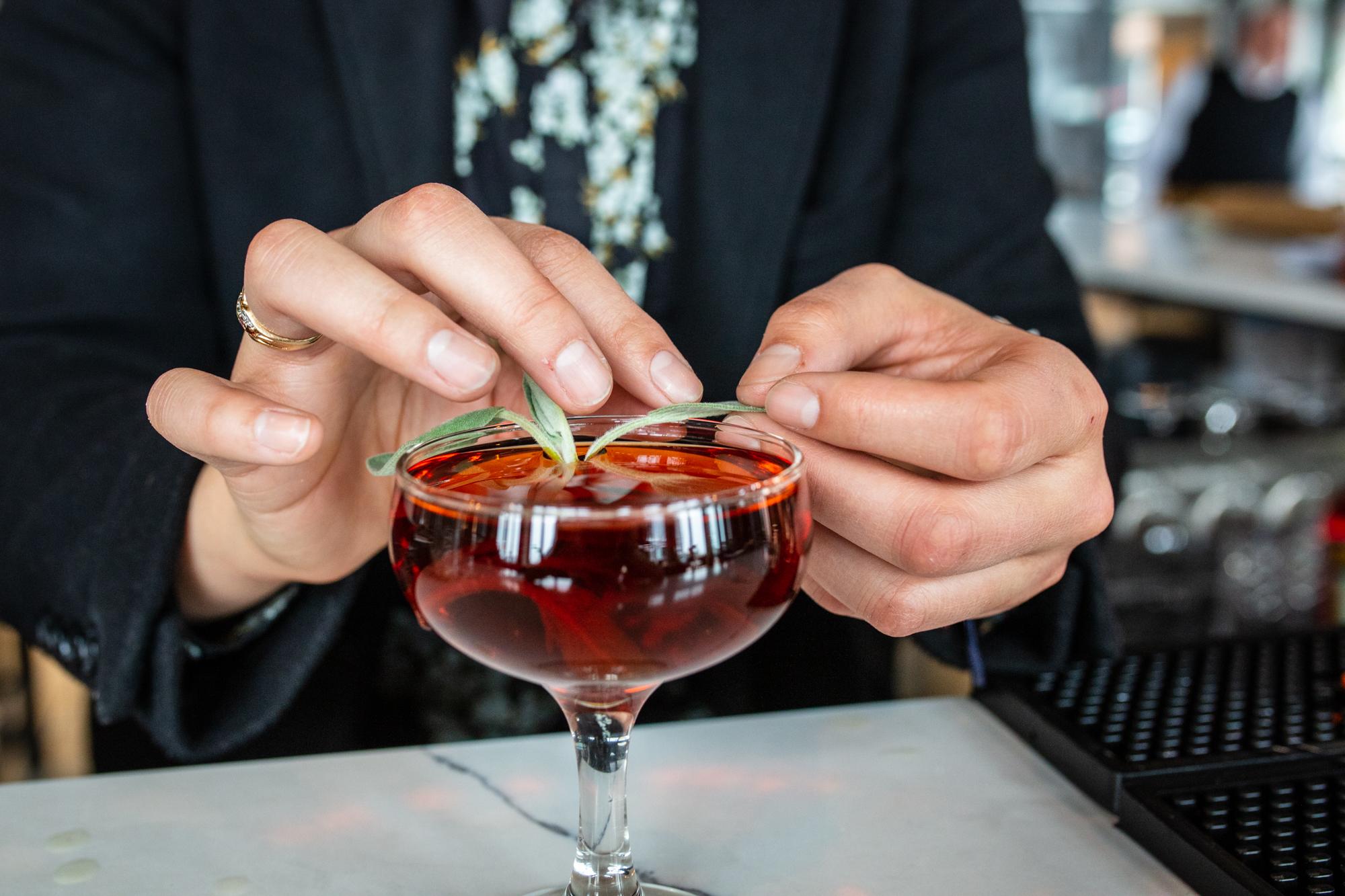 Garnishing Drink_credit Drew Katz.jpg