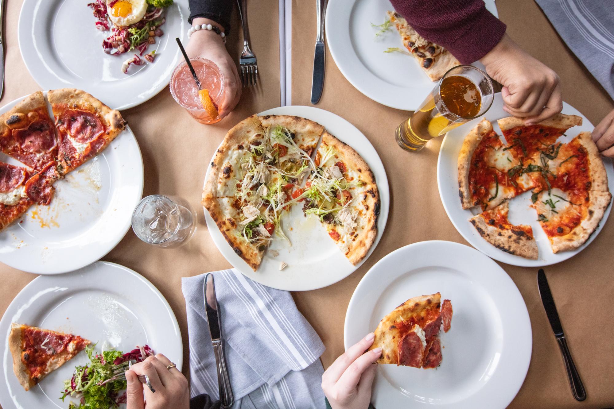 Eating Pizza_credit Drew Katz (2).jpg