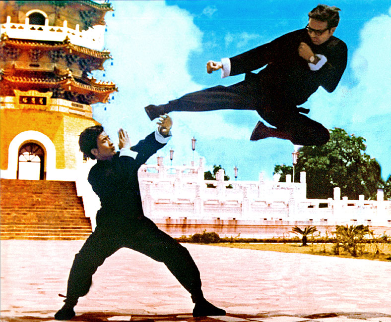Senior Grandmaster Lee performing his classic flying sidekick with Li Kuo Wang in front of the Tsuen Ta Pagoda at Sun Moon Lake - Republic of China, 1972.