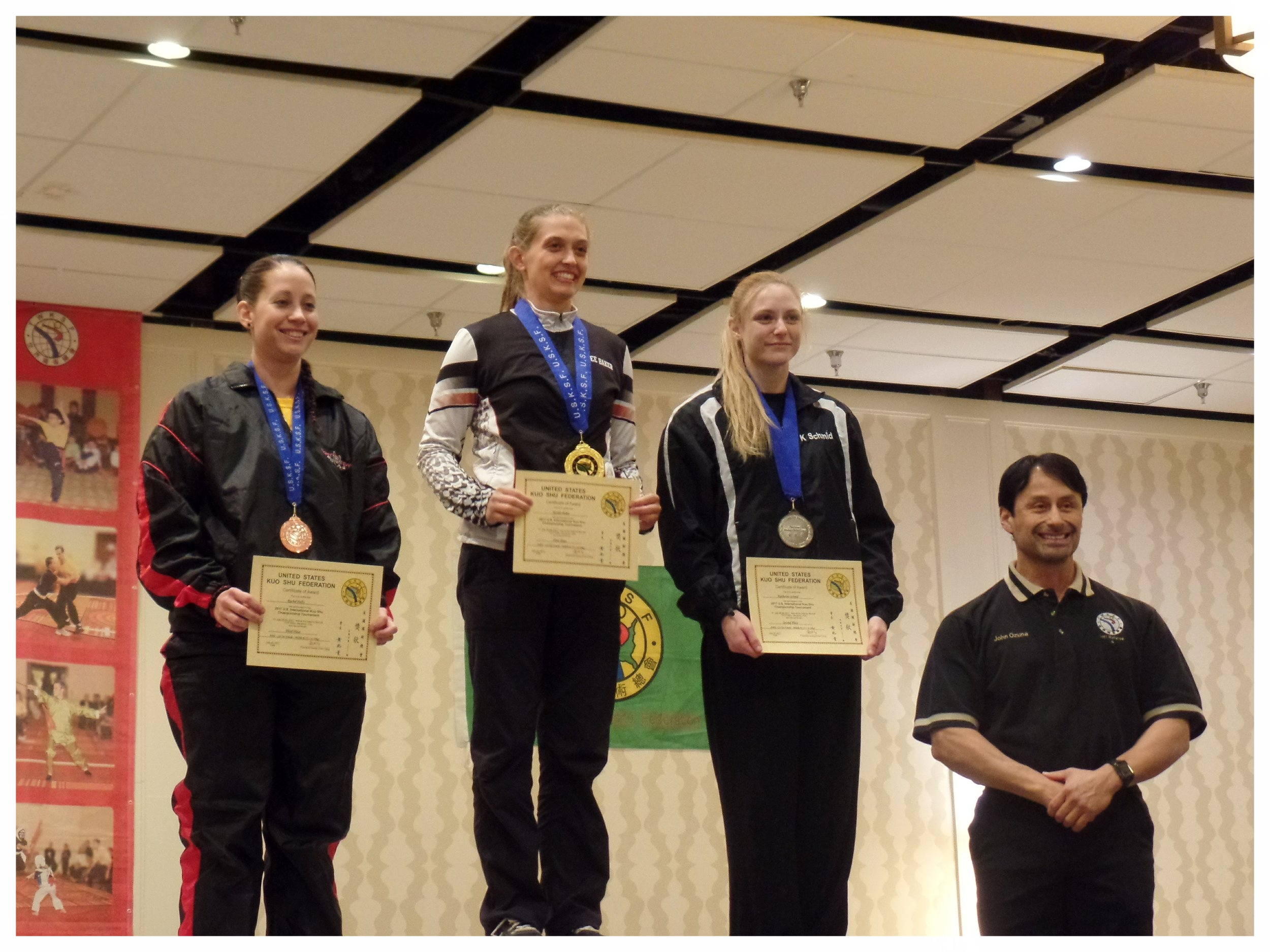 Katie Schmid receives 2nd place in Lei Tai fighting with Master Ozuna at the USKSF International Championship tournament, 2017