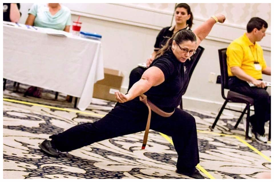 Mary Schmid competes with a Kenpo Form at the USKSF US International Championship tournament, 2016