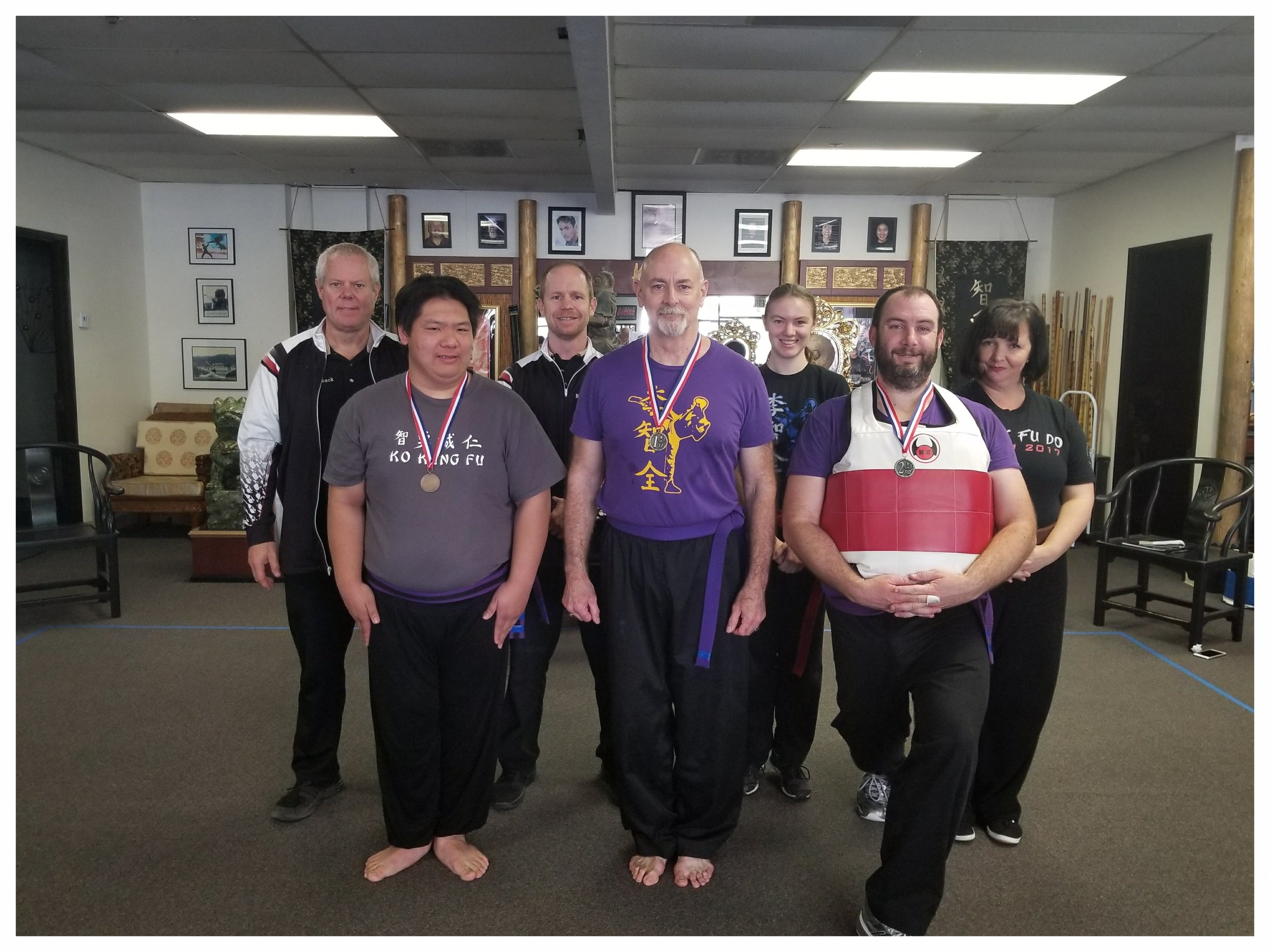 Arik Broman and fellow competitors receive their medals for the Kenpo Weapons division at the West Coast Regional Winter Kuo Shu Championship Tournament, 2018