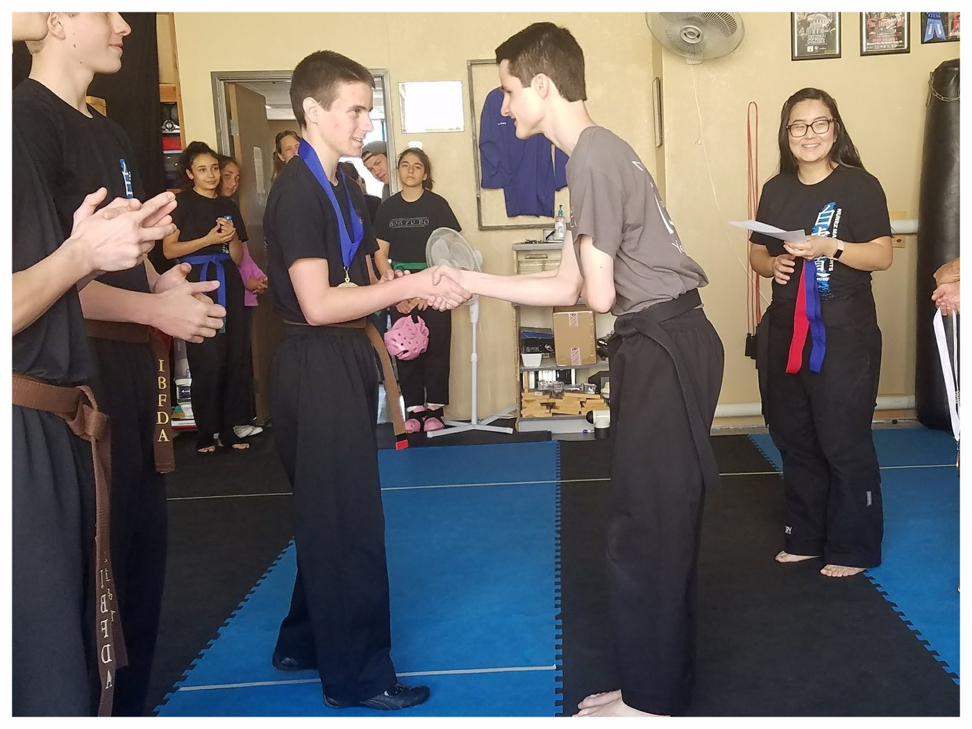 William Solovei receives a medal after competing at the Nunez Martial Arts Academy Anniversary Tournament, 2017