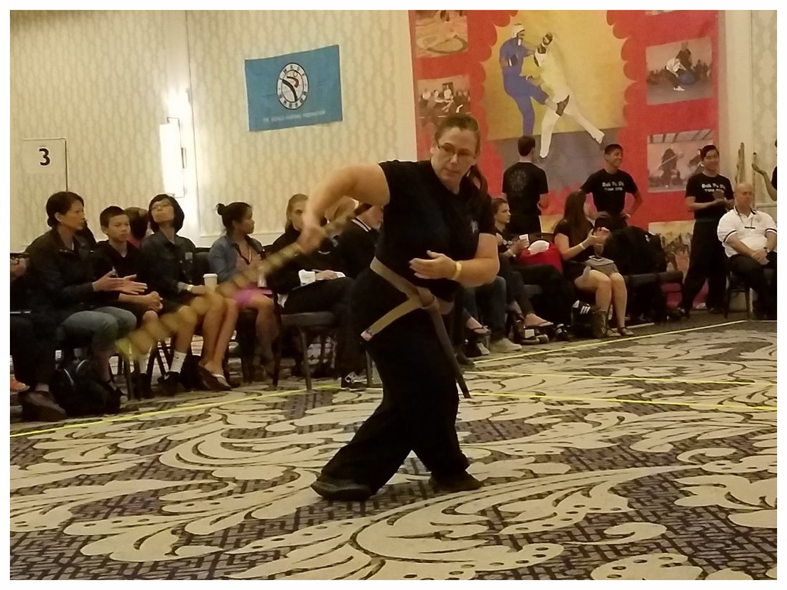 Mary Schmid competes with a Kenpo weapon at the USKSF US International Championship tournament, 2016