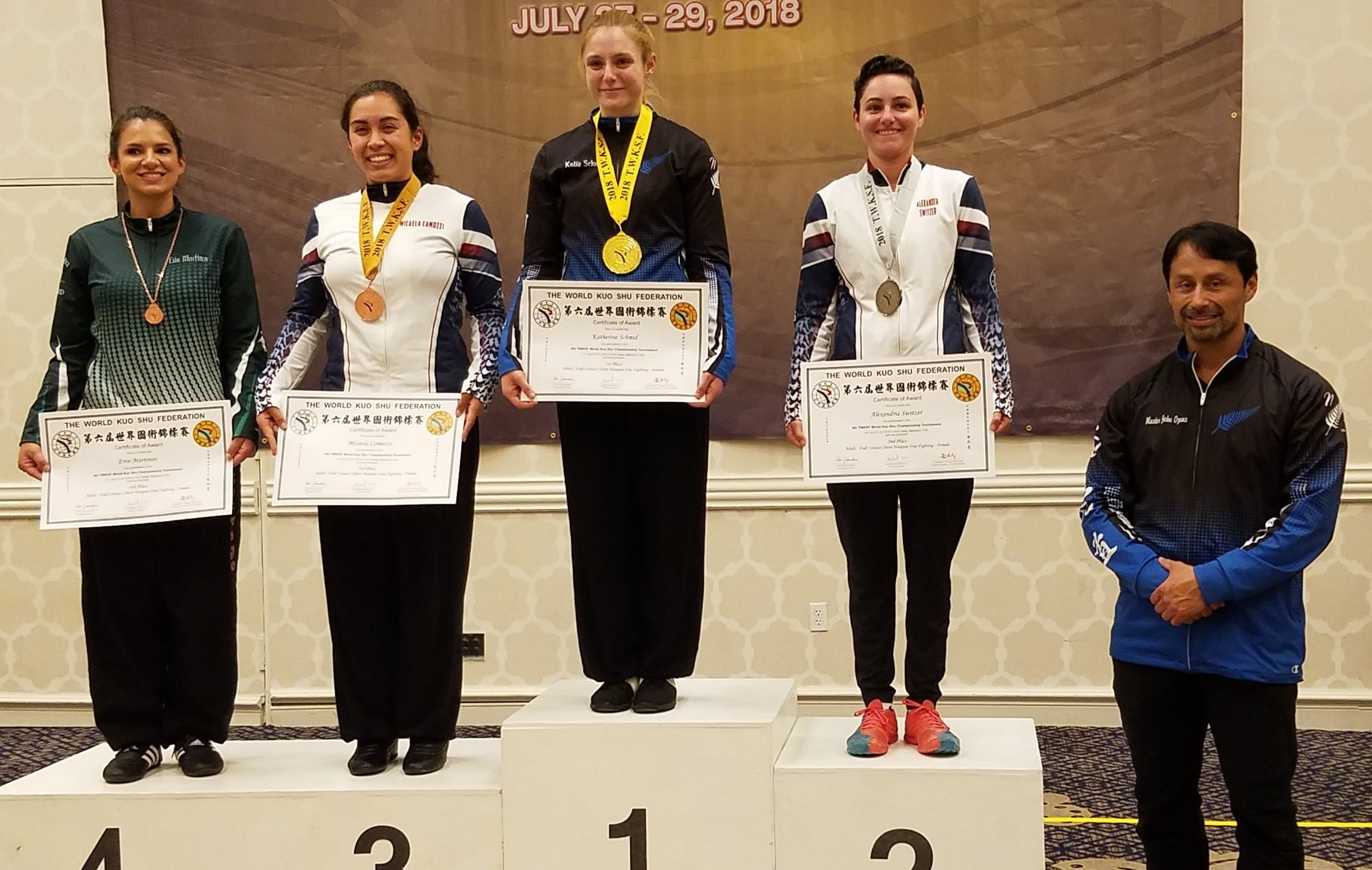 Katie Schmid receives her first place medal in Full Contact Short Weapons Fighting at the 6th TWKSF World Championships in the United States