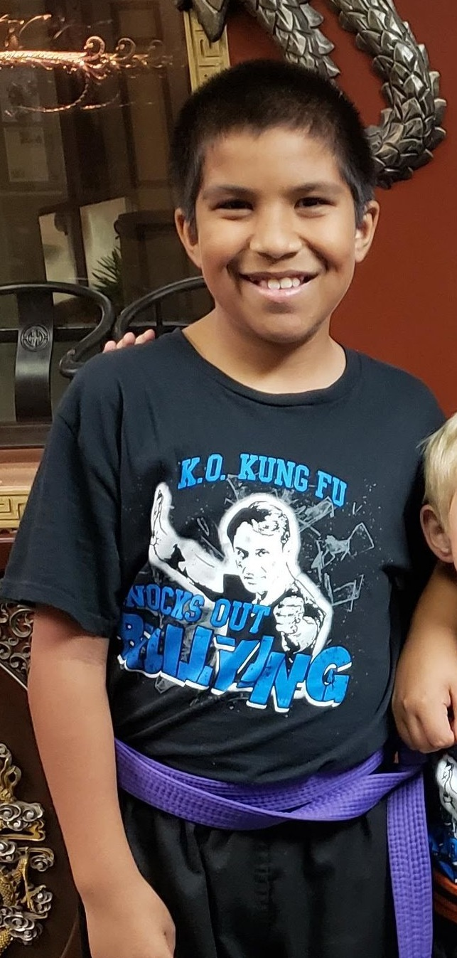 """Nolan Temple shows his school pride modeling K.O. Kung Fu's """"Knock Out Bullying"""" campaign t-shirt"""