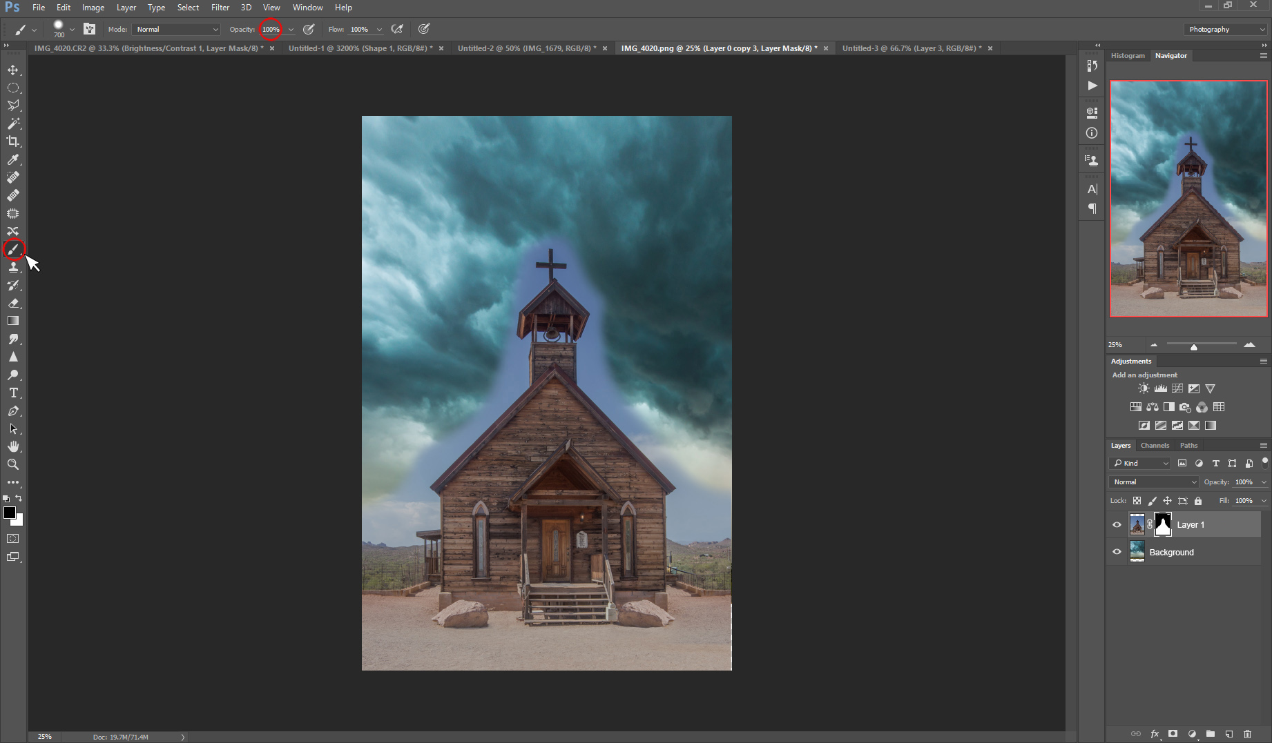 Select the brush tool at 100% Opacity and use it to roughly mask out the blue sky around the church.