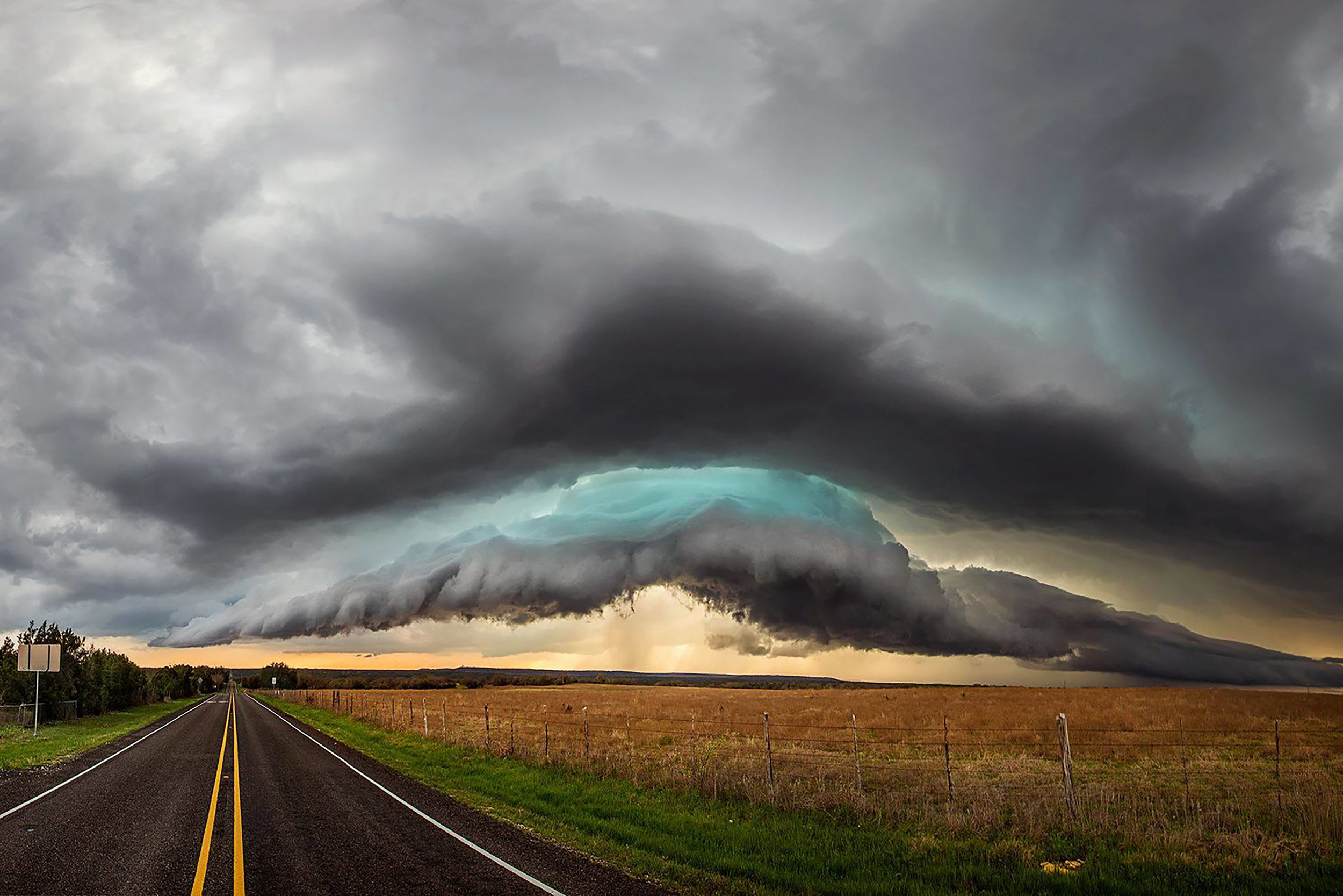 First storm of 2016 produced an incredibly photogenic, glowing green shelf cloud over Evant, Tx.